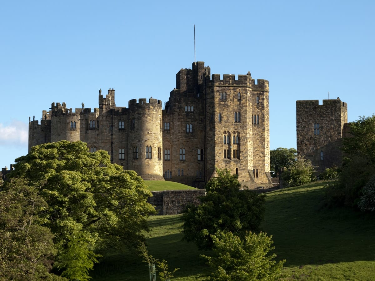 Alnwick Castle, seat of the Duke and Duchess of Northumberland is an iconic site on the banks of the River Aln